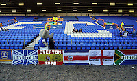 Pictured: The Everton mascon walks past Everton flags. Sunday 16 February 2014<br /> Re: FA Cup, Everton v Swansea City FC at Goodison Park, Liverpool, UK.