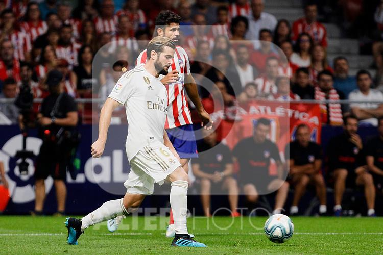 Diego Costa of Atletico de Madrid and Nacho Fernandez of Real Madrid during La Liga match between Atletico de Madrid and Real Madrid at Wanda Metropolitano Stadium{ in Madrid, Spain. {iptcmonthname} 28, 2019. (ALTERPHOTOS/A. Perez Meca)