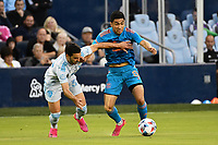 KANSAS CITY, KS - MAY 29: Memo Rodriguez #8 Houston Dynamo holds off Luis Martins #36 Sporting KC during a game between Houston Dynamo and Sporting Kansas City at Children's Mercy Park on May 29, 2021 in Kansas City, Kansas.