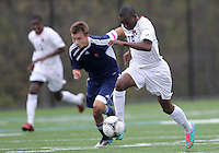 HYATTSVILLE, MD - OCTOBER 26, 2012:  Chris Odoi-Atsem (18) of DeMatha Catholic High School races away from Nelson Reed (11) of St. Albans on his way to score the second goal during a match at Heurich Field in Hyattsville, MD. on October 26. DeMatha won 2-0.