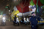 NEW YORK, NY – NOVEMBER 21: A group of New York City police pull people out while organizing safety measures for the annual Macy's Thanksgiving Day parade the night before the parade on November 21, 2018 in New York City. (Photo by Gary Hershorn/VIEWPress)
