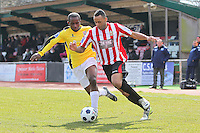 Chris Bourne of Hornchurch rounds Carlos Talbot of Bromley - AFC Hornchurch vs Bromley - Blue Square Conference South Football at The Stadium, Upminster Bridge, Essex - 01/04/13 - MANDATORY CREDIT: Gavin Ellis/TGSPHOTO - Self billing applies where appropriate - 0845 094 6026 - contact@tgsphoto.co.uk - NO UNPAID USE.