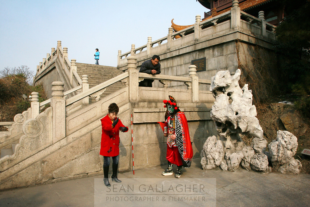 CHINA. Hubei Province. Wuhan. A woman training a man in traditional Chinese performing arts outside of The Yellow Crane Tower which looks over the Yangtze and the city of Wuhan.Wuhan (population 4.3 million) is a sprawling city that sits on both sides of the Yangtze River.  2008