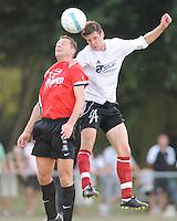 Finale Mandelcup : KFC Izegem - Winkel Sport..Wim Vandoorne klimt hoger dan Vincent Bostoen (links)..foto VDB / BART VANDENBROUCKE