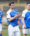 Stranraer's Martin Greehan at the end of the game .......