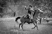 Train robbery, cowboys on horseback. Riding with guns. Western theme. Kettle Valley Railway. Summerland B.C.