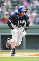 Outfielder Delta Cleary Jr. (24) of the Asheville Tourists, a Colorado Rockies affiliate, in a game against the Greenville Drive on May 14, 2012, at Fluor Field at the West End in Greenville, South Carolina. Asheville won, 11-6. (Tom Priddy/Four Seam Images)