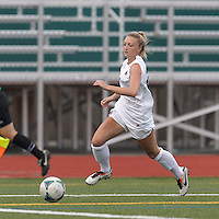 Boston Aztec forward Lucy Gildein (27) dribbles down the wing. In a Women's Premier Soccer League (WPSL) match, Boston Aztec (white) defeated Seacoast United Phantoms (blue), 3-0, at North Reading High School Stadium on Arthur J. Kenney Athletic Field on on June 25, 2013.