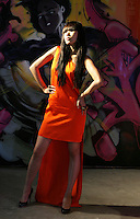 08/09/2010.Model Yomiko wearing a burnt orange asymmmetric shoulder dress with train by Stella McCartney with navy python shoes by Christian Louboutin .at Harvey Nichols Autumn/Winter Collection 2010 at Harvey Nichols Dundrum Shopping Centre, Dublin..Photo: Gareth Chaney Collins