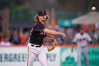 San Jose Giants starting pitcher Garrett Cave (32) attempts to pick off a runner at first base during a California League game against the Visalia Rawhide on April 12, 2019 at San Jose Municipal Stadium in San Jose, California. Visalia defeated San Jose 6-2. (Zachary Lucy/Four Seam Images)