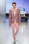 """Model walks runway in an outfit from the Nick Graham Spring Summer 2019 """"1969"""" collection in at Cadillac House in New York City on July 10, 2018; during New York Fashion Week: Men's Spring Summer 2019."""