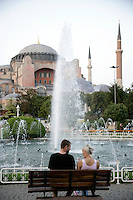 Young couple in front of the Hagia Sophia, Istanbul, Turkey
