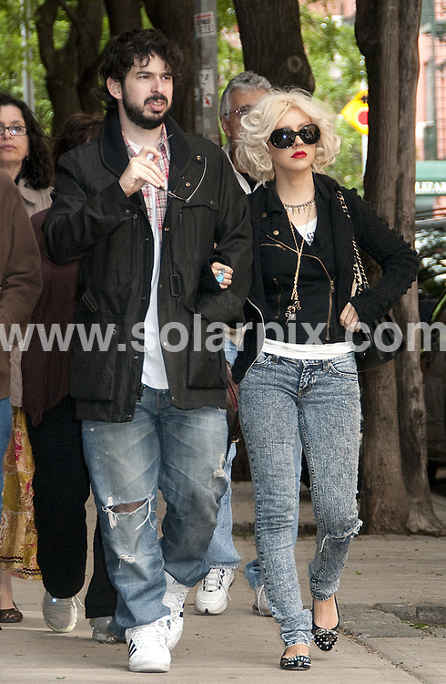 **ALL ROUND PICTURES FROM SOLARPIX.COM**.**SYNDICATION RIGHTS FOR UK, AUSTRALIA, DENMARK, PORTUGAL, S. AFRICA, SPAIN & DUBAI (U.A.E) & ASIA (EXCLUDING JAPAN) ONLY**.Christina Aguilera and Jordan Bratman Sighted in Soho, New York City, NY, USA, 09 May 2010.This pic: Christina Aguilera and Jordan Bratman .JOB REF: 11229  PHZ mayer   DATE: 09_05_2010.**MUST CREDIT SOLARPIX.COM OR DOUBLE FEE WILL BE CHARGED**.**MUST NOTIFY SOLARPIX OF ONLINE USAGE**.**CALL US ON: +34 952 811 768 or LOW RATE FROM UK 0844 617 7637**