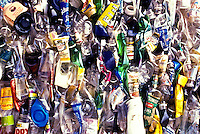 Close-up of plastic and glass bottles and containers at a recycling center near Kona, Big Island of Hawaii.