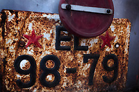 Albania. Elbasan. An old rusty communist license plate on a derelict truck in an abandoned factory. Red stars. The factory stopped functioning at the fall of the communist system. Elbasan is a city and a municipality in Elbasan County, central Albania. 20.05.2018 © 2018 Didier Ruef