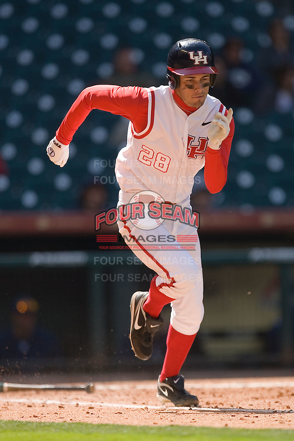 Caleb Ramsey #28 of the Houston Cougars hustles down the first base line versus the UC-Irvine Anteaters in the 2009 Houston College Classic at Minute Maid Park February 28, 2009 in Houston, TX.  The Anteaters defeated the Cougars 13-7. (Photo by Brian Westerholt / Four Seam Images)