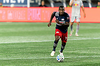 FOXBOROUGH, MA - AUGUST 29: Cristian Penilla #70 of New England Revolution brings the ball forward during a game between New York Red Bulls and New England Revolution at Gillette Stadium on August 29, 2020 in Foxborough, Massachusetts.
