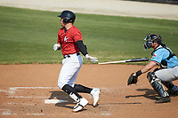Corey Zangari (25) of the Kannapolis Intimidators follows through on his swing against the Hickory Crawdads at Kannapolis Intimidators Stadium on June 2, 2019 in Kannapolis, North Carolina. The Intimidators defeated the Crawdads 4-3. (Brian Westerholt/Four Seam Images)