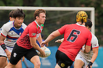 Ryno De Bruyn (2nd from l) of United Arab Emirates runs with the ball during the match between South Korea and United Arab Emirates of the Asia Rugby U20 Sevens Series 2016 on 12 August 2016 at the King's Park, in Hong Kong, China. Photo by Marcio Machado / Power Sport Images