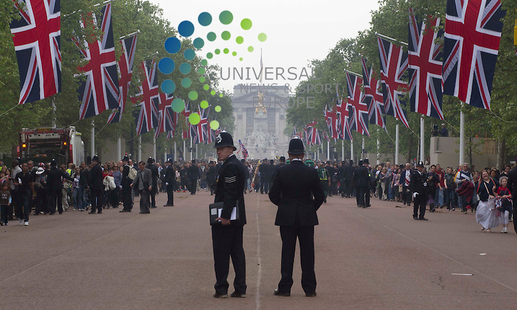 Police clear the roads after the public walk down the mall after Princess Kate and Prince William drive to the Buckingham Palace. .Picture: Maurice McDonald/Universal News And Sport (Europe).29 April 2011..