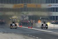 Apr. 30, 2011; Baytown, TX, USA: NHRA top fuel dragster driver Del Worsham (left) races alongside David Grubnic during qualifying for the Spring Nationals at Royal Purple Raceway. Mandatory Credit: Mark J. Rebilas-