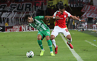 BOGOTÁ- COLOMBIA, 29-10-2019:Edwin Herrera (Der.) jugador del Independiente Santa Fe    disputa el balón contra Alberto Costa (Izq.) jugador del Atlético Nacional durante partido por la fecha 20 de la Liga Águila II  2019 jugado en el estadio Nemesio Camacho El Campín  de la ciudad de Bogotá. /Edwin Herrera (R) player of Independiente Santa Fe  fights for the ball  against of Alberto Costa (L) player of Atletico Nacional during the match for the date 20 of the Liga Aguila II 2019 played at the Nemesio Camacho El Campin  stadium in Bogota city. Photo: VizzorImage / Felipe Caicedo / Staff