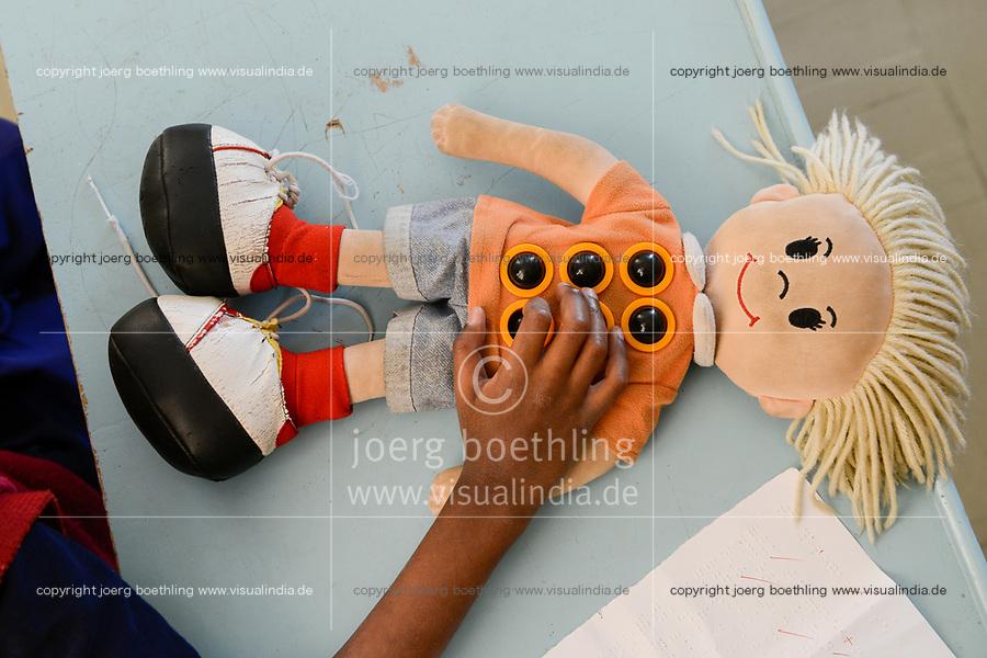 ETHIOPIA, Amhara, Gondar, school for blind children, doll with button to learn the sense of touch / AETHIOPIEN, Amhara, Gonder, Schule fuer blinde Kinder, Puppe mit Knoepfen zum erlernen des Tastsinn