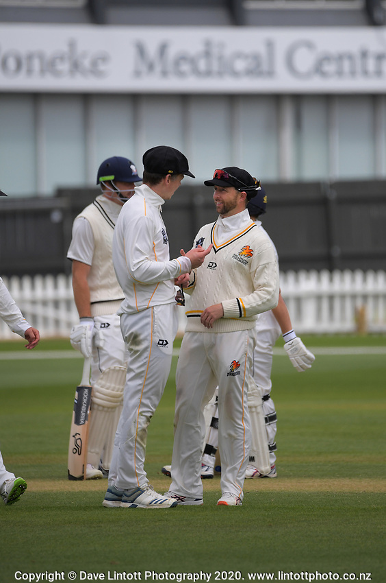 Michael Bracewell chats with Devon Conway during day four of the Plunket Shield match between the Wellington Firebirds and Auckland Aces at the Basin Reserve in Wellington, New Zealand on Tuesday, 17 November 2020. Photo: Dave Lintott / lintottphoto.co.nz