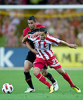 MELBOURNE, AUSTRALIA - NOVEMBER 19: Adrian Zahra of the Heart and Lucas Pantelis of Adelaide in action during the round 15 A-League match between the Melbourne Heart and Adelaide United at AAMI Park on November 19, 2010 in Melbourne, Australia (Photo by Sydney Low / Asterisk Images)