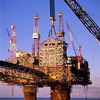 Lifting gas compression module onto oil production platform, North Sea..