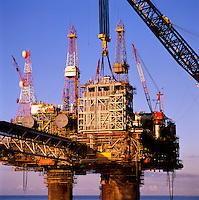 Lifting gas compression module onto oil production platform, North Sea..