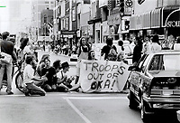 Downtown sit-in: Students protesting the presence of troops at Oka; Que.; block Yonge and Bloor Sts. yesterday; stopping afternoon rush hour traffic. The demonstration ended peacefully after a half-hour.<br /> <br /> Photo : Boris Spremo - Toronto Star archives - AQP