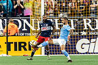 FOXBOROUGH, MA - SEPTEMBER 11: Valentin Castellanos #11 of New York City FC collects a pass as Andrew Farrell #2 of New England Revolution defends during a game between New York City FC and New England Revolution at Gillette Stadium on September 11, 2021 in Foxborough, Massachusetts.
