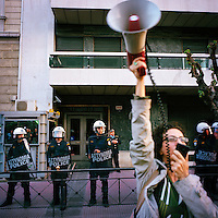 A woman from the Communist Party of Greece (KKE) shouting slogans during a demonstration in the midst of the financial crisis.