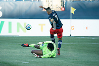FOXBOROUGH, MA - SEPTEMBER 19: Sean Johnson #1 of New York City FC and Gustavo Bou #7 of New England Revolution tangle near the New York City goal during a game between New York City FC and New England Revolution at Gillette on September 19, 2020 in Foxborough, Massachusetts.