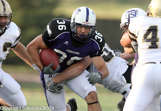 SIOUX FALLS, SD - SEPTEMBER 5:  Kristian Porter #36 of the University of Sioux Falls looks for an opening in the Nebraska Wesleyan defense in the second quarter of their game Saturday evening at the USF Sports Complex. (Photo by Dave Eggen/Inertia).
