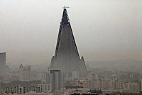 The unfinished 330 meter tall Ryugyong Hotel. The Hotel has remained unfinished since 1992, there are rumours of structural frailty and also pulling out of funding partners.