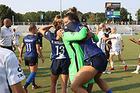 CARY, NC - SEPTEMBER 12: Cari Roccaro #21 of the North Carolina Courage and Abby Smith #35 of the Portland Thorns FC embrace after a game between Portland Thorns FC and North Carolina Courage at Sahlen's Stadium at WakeMed Soccer Park on September 12, 2021 in Cary, North Carolina.