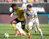 CHARLOTTE, NC - JULY 20: Lorenzo Venuti #2 chases Bukayo Saka #77 during a game between ACF Fiorentina and Arsenal at Bank of America Stadium on July 20, 2019 in Charlotte, North Carolina.