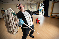 Phantom of the Mop(era)... School cleaner stuns pupils with his operatic performances.