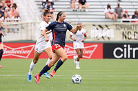 CARY, NC - APRIL 10: Ashley Hatch #33 of the Washington Spirit is chased by Carson Pickett #4 of the North Carolina Courage during a game between Washington Spirit and North Carolina Courage at Sahlen's Stadium at WakeMed Soccer Park on April 10, 2021 in Cary, North Carolina.