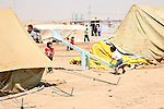 DOMIZ, IRAQ: Children play on a see-saw in the Domiz refugee camp...Over 7,000 Syrian Kurds have fled the violence in Syria and are living in the Domiz refugee camp in the semi-autonomous region of Iraqi Kurdistan...Photo by Ari Jalal/Metrography
