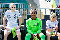 CARY, NC - SEPTEMBER 12: Olivia Moultre #42, Abby Smith #35, and Madison Pogarch #15 of the Portland Thorns sit on the bench before a game between Portland Thorns FC and North Carolina Courage at WakeMed Soccer Park on September 12, 2021 in Cary, North Carolina.