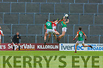 David Roche Mid Kerry claims the ball from the sky ahead od his team mate Ronan Murphy and Kilcummin Sean O'Leary during their SFC clash in Fitzgerald Stadium on Saturday