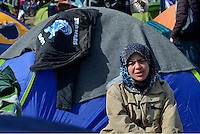 Pictured: A migrant mother in the camp  Tuesday 01 March 2016<br /> Re: Thousands of migrants, still stranded at the Greek FYRO Macedonian border in Idomeni, Greece