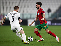 Footbal Soccer: FIFA World Cup Qatar 2022 Qualification, Portugal - Azerbaijan, Allianz Stadium , Turin, March 24, 2021.<br /> Portugal's Bruno Fernandes (R) in action with Azerbaijan's captain Maksim Medvedev (L) during the FIFA World Cup Qatar 2022 qualification, football match between Portugal and Azerbaijan, at Allianz Stadium in Turin, on March 24, 2021.<br /> UPDATE IMAGES PRESS/Isabella Bonotto