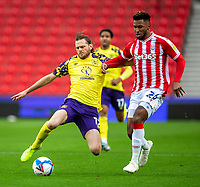 21st November 2020; Bet365 Stadium, Stoke, Staffordshire, England; English Football League Championship Football, Stoke City versus Huddersfield Town; Richard Stearmen of Huddersfield Town tackles Tyrese Campbell of Stoke City