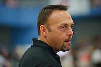 LOS ANGELES, CA - February 5, 2012:  Stanford associate head coach Chris Swercik during competition against the UCLA Bruins at the Wooden Center.   UCLA defeated Stanford, 197.250 - 196.450.