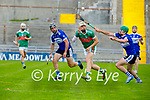 Shane Nolan hand passes the sliotar on the run after losing his hurley as Stephen Leen and Eric Leen races towards him, in the County Senior Hurling Championship quarter final