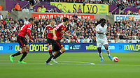 Pictured: Bafetimbi Gomis of Swansea (R) takes a shot off target  Sunday 30 August 2015<br /> Re: Premier League, Swansea v Manchester United at the Liberty Stadium, Swansea, UK